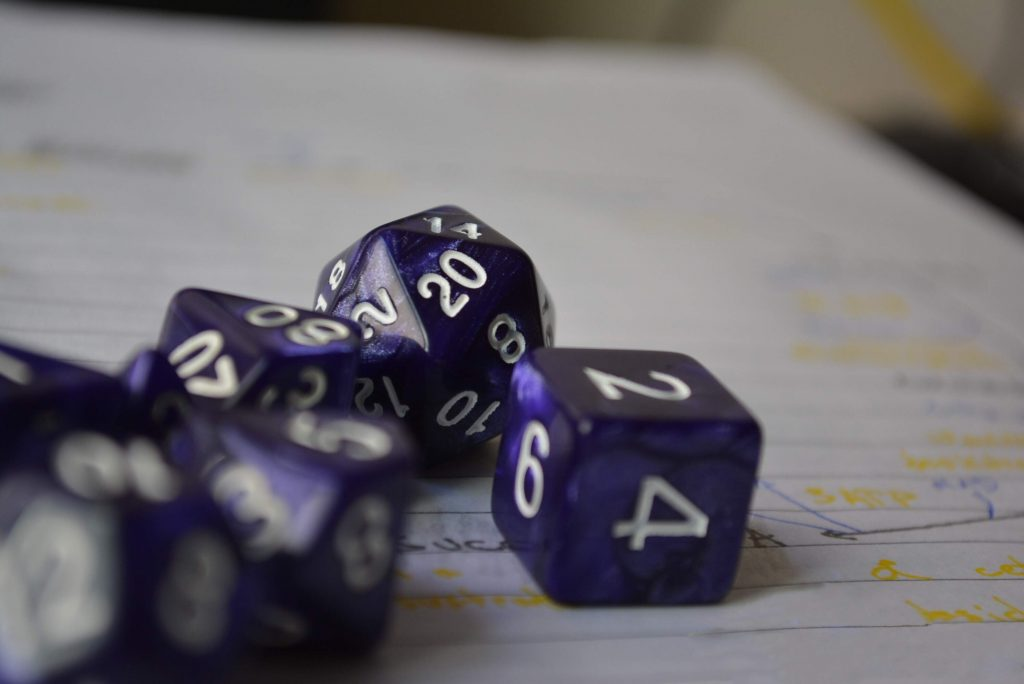 picture of dice making an ability check