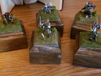 5 hero forge minis, from left to right: high elf rogue, wood elf monk, teifling witch, halfling ranger, dragonborn warlock