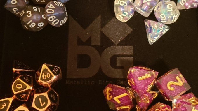 All four sets of Metallic Dice Games dice on the black velvet dice try