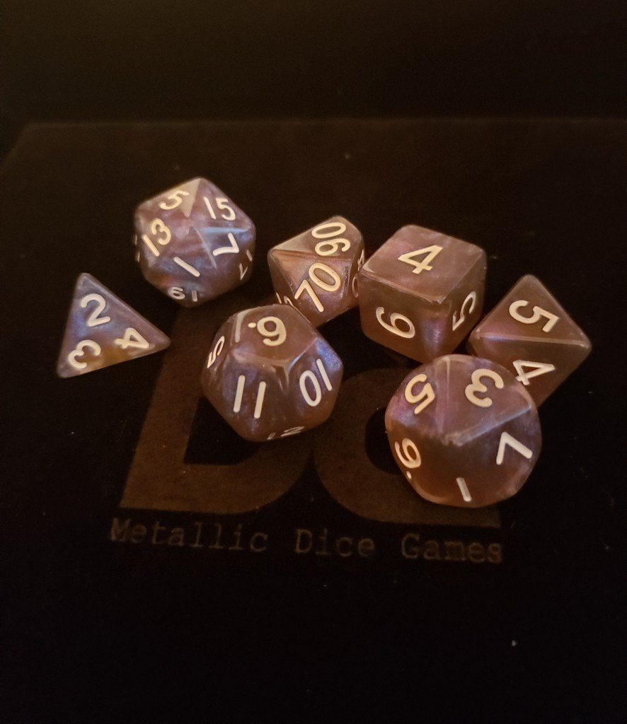 Stardust Galaxy. Black and blue dice with glitter